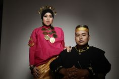 Wearing traditional dresses from south sulawesi, Indonesia.