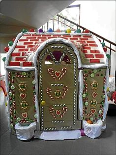 Building a gingerbread house. turning a kids playhouse into a gingerbread house.