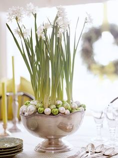 """Natural Centrepiece.. potted paperwhites (narcissus) as a holiday floral .. display them in a silver footed bowl cleverly """"mulched"""" with tiny green, cream, and silver ball ornaments."""