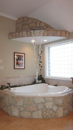master Bath Stone waterfall feature fills the Bubble jet Tub from above! #Bathtubs