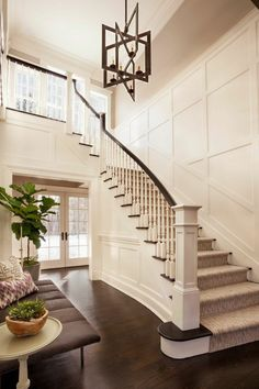 This soaring foyer houses a gorgeous geometric chandelier and a lovely staircase. Leaving the second floor open to the space below allows the room to remain feeling large and airy.