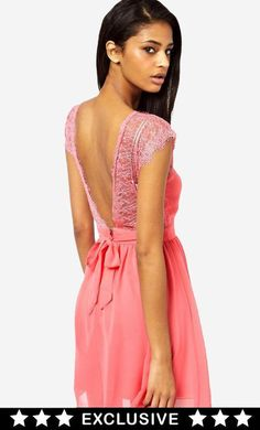 Made from a poly lace. V-neckline with a scalloped edge. Fitted waist with a tie to back. Concealed...