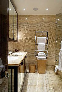 Bathroom in bookmatched Camello onyx, polished finish. This dramatic onyx  is ideal for bookmatching