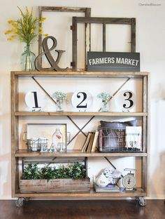 This large dining room bookshelf is the perfect place to display your favorite farmhouse finds! @Shutterfly #ad #ourhomeourstory