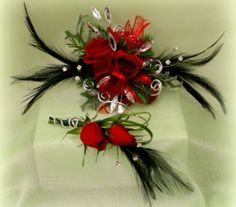Dance with Diamonds this year! Ruby red roses, silver bling, and black feathers accent the evening with flare. PC-45