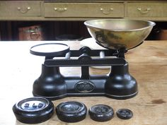 Kitchen scales with weights.  Maker: Salter. Located in the Georgian Kitchen, Culzean Castle.