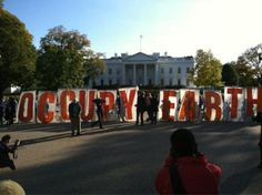 From Getty: Demonstrators hold up a banner in front of the White House in Washington, DC November 6, 2011.