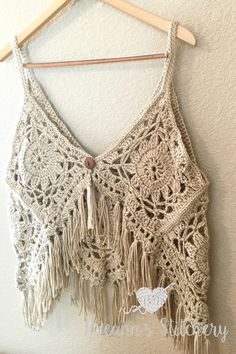 I love this fun, funky, fring-y Boho Tank Top Crochet Pattern! It's super cute layered with long necklaces over a sundress. You could even use cotton yarn and wear it over a bathing suit. It has a button closure on the back andI actually wore it backwards as a vest the other day.  Gotta …