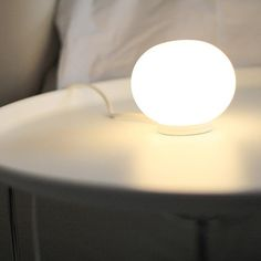 Mini Glo-Ball table lamp by Jasper Morrison for FLOS. A magical and beautiful accent for nightstands, bookshelves, desks and more.