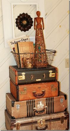 love using old suitcases like this. we have a stack in the den we use for a side table next to a chair. =)