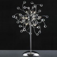 Sophisticated table lamp  Find more inspirations: www.luxxu.net #luxurylighting #lightingdesign #tablelamps