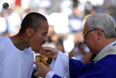 Mara Salvatrucha Gang member receives communion at Ciudad Barrios prison.