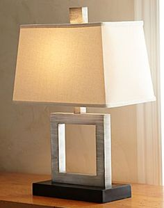 CopyCatChic.com blog (wonderful!). The Crate & Barrel's Duncan Antiqued Silver Table Lamp is $249 while this JCPenney's Silver Open Square Table Lamp is $27.99