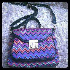 Beautiful Colorful Small Shoulder Bag I wore this bag once and got many complements. I am just use to much bigger bags and that is why I am selling this bag. The inside is still roomy and does have a zip area as well. Colors pink, blue, orange, yellow and black. Bags Shoulder Bags