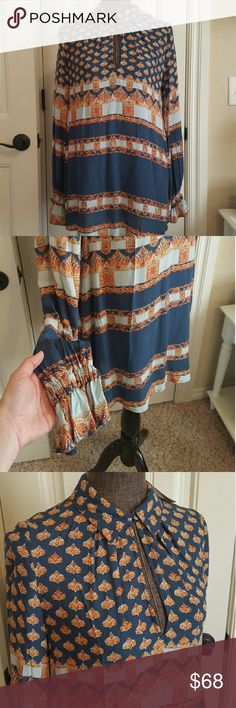 """Sale* [Free People] Abstract Tunic Blouse Long and flowy abstract tunic. Great with leggings or jeans! Deep keyhole cutout. 100% Rayon material. 30"""" in length, bust is 29"""" when laid flat. Lightweight and a beautiful blouse for the current and upcoming season! Free People Tops Blouses"""