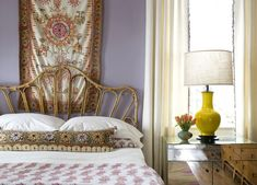 Rattan bed, wall hanging, mirrored nightstand.  Eclectic glam