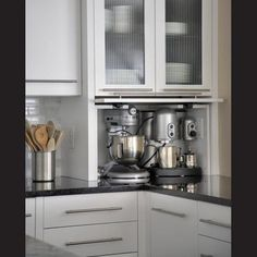 Larger appliances hidden, but able to simply pull out to use or use where sitting behind cabinet.