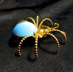 Large Vintage Spider Brooch with Blue Belly and Rhinestone Head via Etsy