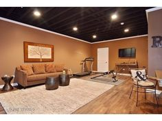 nicely finished basement with painted exposed ceiling