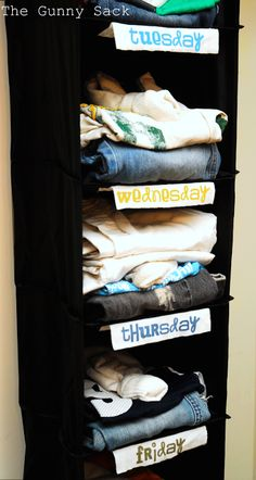 I loved this idea and did it in Ellie, Sam, and Marie's closet.  It makes mornings and getting ready for bed easy (I also put their pajamas for each day in the shelves.).
