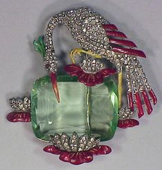 Trifari Stork Pin Painted enamel stork with rhinestones set against a large green crystal stone.
