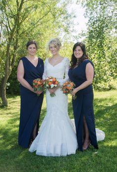 Wedding of the Week: Alix Howard and Joshua MiddletonWedding of the Week: Alix Howard and Joshua Middleton | Navy bridesmaids' dresses with orange bouquets | bridemagazine.co.uk