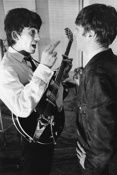 George Harrison and John Lennon of British rock band The Beatles at Abbey Road Studio