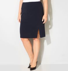 Plus size pencil skirt.   Stretch.   Zipper with hook and eye closure at the back.    Slit at the wearer's left side.   Lined.   Polyester/rayon/spandex. Machine wash. Imported.   Approx. 25 inches long.