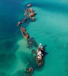 Tangalooma Wrecks, Moreton Bay, Queensland, Australia - Fifteen vessels have been deliberately sunk on the landward side of Moreton Island to form a breakwall for small boats and a wreck dive and snorkel site. The Tangalooma Wrecks provide good diving in depths from 2-10m. Even in this shallow water, the wrecks attract an amazing amount of marine life, including wobbegongs, trevally, kingfish, yellowtail and lots of tropical fish.