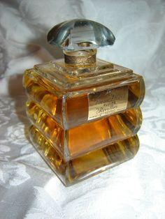 Clear glass perfume bottle. So sweet.