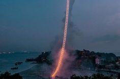 """""""Sky Ladder"""" is pyrotechnic artwork by Cai Guoqiang, a Chinese artist. Cai uses gunpowder in his incredible works of art and it is truly spectacular. Sky Ladder, Buzzfeed Video, Fire Works, Strange Places, Sky Photos, Stairway To Heaven, Optical Illusions, Pretty Pictures, Life Is Beautiful"""