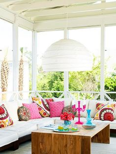 beautiful bench, pillows, and table
