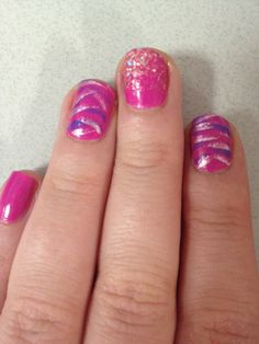 Magenta and zebra nail design