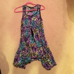 Multi colored uneven hem dress Elastic waist, buttons on front, tank detailing, flowy skirt and uneven hem. Purple, green, black, yellow and white coloring Forever 21 Dresses