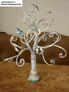 This site is in Russian, but there's a nice photo tutorial on how to make a tree out of rolled magazine pages