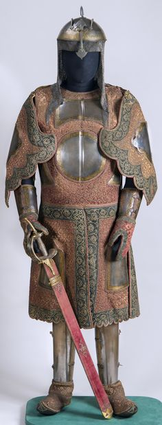 Chilta hazar masha (coat of a thousand nails), kulah khud (helmet), bazu band (arm guards). Indian armored clothing made from layers of fabric faced with velvet and studded with numerous small brass nails, which were often gilded. Fabric armor was very popular in India because metal became very hot under the Indian sun. This example has additional armor plates on the chest area, arms, and thighs. Hermitage Museum.