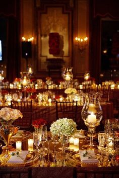 soft romantic candle lit tablescape emphasized with mirrored surface.