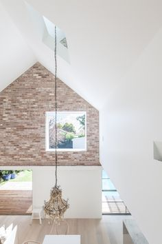 Tribe Studio | House Maher | Formally, the house is a simple gable extrude, clad on the street ends in face brickwork. Internally, the spaces are a playful study in volume and light.