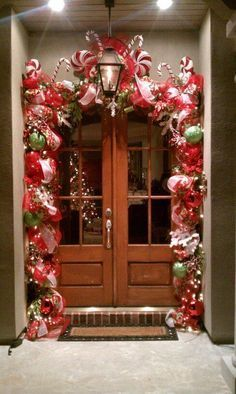 48 Stunning Christmas Door Decoration Ideas For Every Home. You will find a good deal of Christmas door decorating ideas for every home. Porch Christmas Lights, Front Door Christmas Decorations, Diy Christmas Garland, Christmas Front Doors, Decorating With Christmas Lights, Noel Christmas, Christmas Entryway, Diy Garland, Garland Ideas