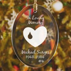 """Forever In Our Hearts Memorial Personalized Oval Glass #Christmas Tree Ornaments. Remember beloved family & friends with our Forever In Our Hearts Personalized Memorial Oval Glass Ornament. Memories of loved ones are a cherished part of Christmas and remembering those who have passed is a time honored tradition. Our Personalized Memorial Ornament measures 3.75"""" x 2.75"""" and includes a golden ribbon loop and Free Gift Pouch. Personalize your ornament with any message, name and dates."""