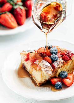 wedge of berry croissant baked french toast on a white plate with rum maple syrup poured from a glass creamer [sponsored] Croissant French Toast, French Toast Waffles, Baked French Toast Casserole, French Toast Bake, Croissants, Miracle Soup Recipe, Berry, Brunch Dishes, Slow Cooker Recipes