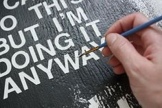 Good DIY tips on how to paint lyrics or words on canvas.