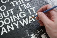Good DIY tips on how to paint lyrics or words on canvas.