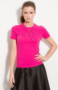 This is adorable-- rhinestone bow trim on sweater. But at $245, I think I'll make my own.