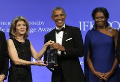 OBAMA RECEIVING PROFILE IN COURAGE AWARD FROM KENNEDYS Former President Barack Obama, center, is presented with the 2017 Profile in Courage award by former U.S. Ambassador to Japan Caroline Kennedy, left, as former first lady Michelle Obama, right, looks on during ceremonies at the John F. Kennedy Presidential Library and Museum, Sunday, May 7, 2017, in Boston
