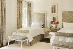 A Brunschwig & Fils print dresses up a guest room; the beds and mirrored chest are Kasler designs for Hickory Chair.