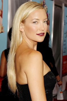 2014 - Want to make the most of long, sleek straight hair? Take a leaf out of Kate Hudson's beauty book and add a strong berry red lip. We love this as it perfectly dispels the myth that dark lipsticks are the remit of cold winters.
