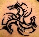 A tribal dragon tattoo uses three dragon heads to create an ever moving cycle of power