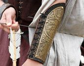 Medieval Elven Archery Bracer Arm Guard etched lightweight armor leather and metal. $83.50, via Etsy.