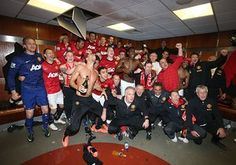2012-13 The Manchester United squad celebrate in the dressing room after the match against Aston Villa at Old Trafford. The 3-0 victory gave them their 20th League title.